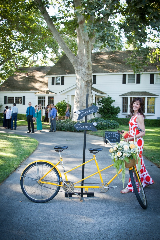 My sister, Cathy posing with the darling bicycle built for two. The Bride and Groom later left on this bike, cutest thing ever.
