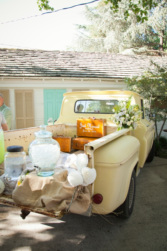 Water and lemonade was served from the tailgate of this 50's pick-up. I die… and the suitcase? what? so cute