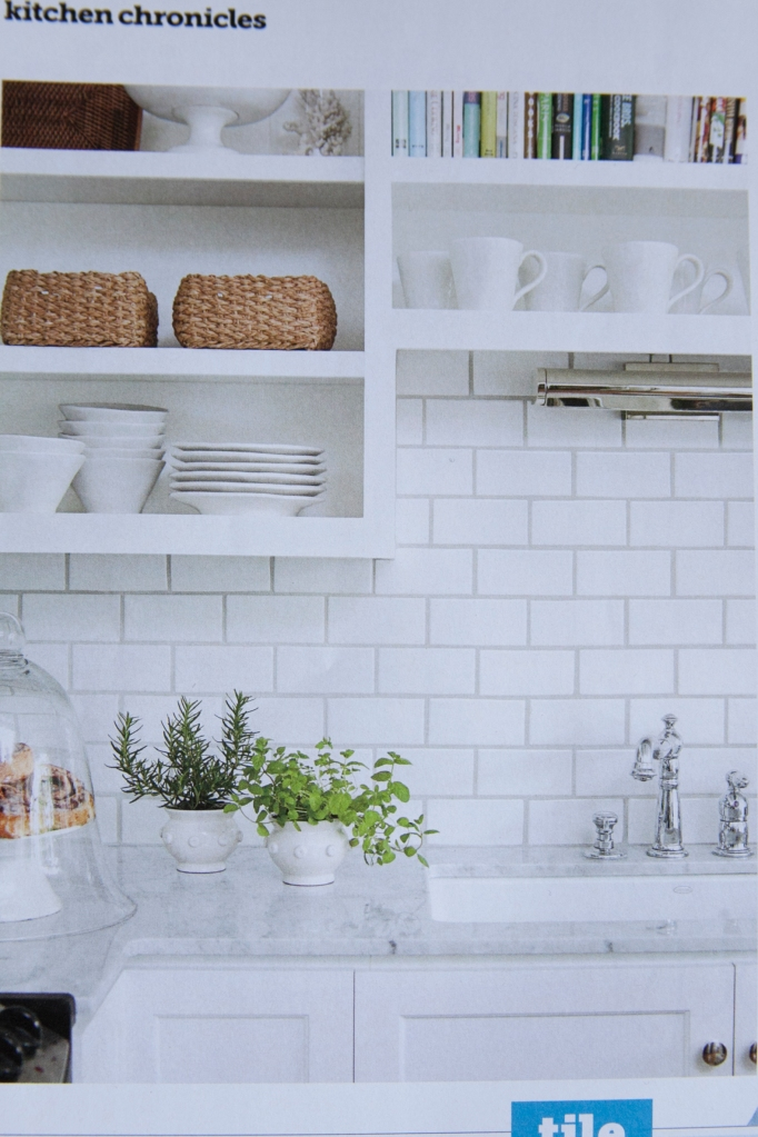 I've been wanting to tile a back splash in our kitchen and I think I'm going to use a white subway tile to do it with! I saw this in a fabulous bakery in Salt Lake City this summer and I'm sold! It looked great and was met with white washed paneling. Look at the next picture.