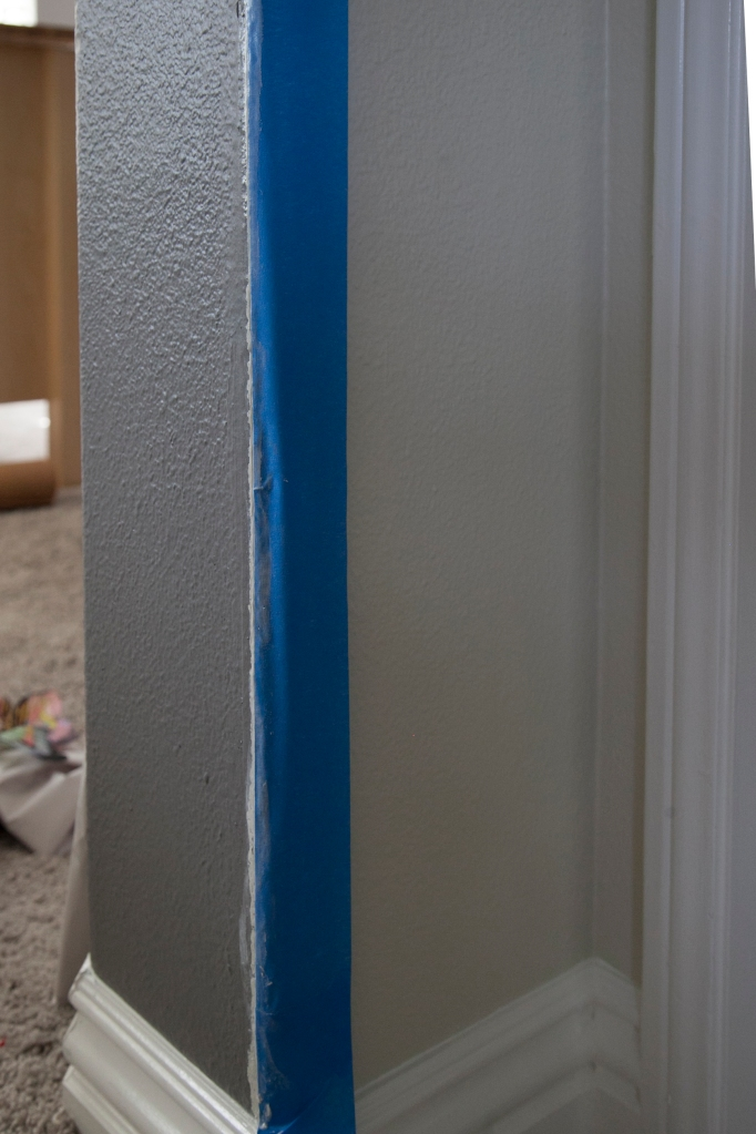 I painted the lighter shade first and when it was dry I placed the tape over it up to the line of the darker color.
