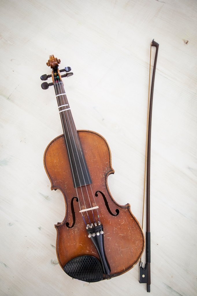 The violin with the original bow.
