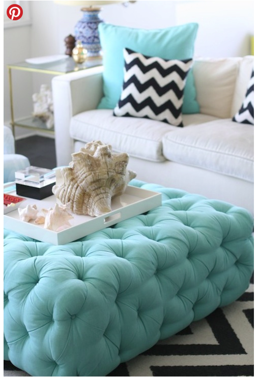 OBSESSED! So i've been looking around for this little fabulous ottoman. My designer sister has confirmed that it is more than likely a custom piece. Of course, I'm already wondering if I could make it somehow…