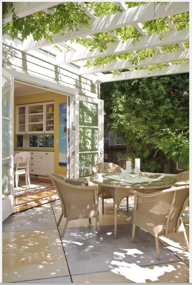 This spot actually looks very much like my back patio entrance. I would LOVE to have a patio cover like this and that little cabinet on the inside over the bottom cabinet is darling. I have a space exactly like that and thinking I should hang an upper cabinet just like that one. Darling!