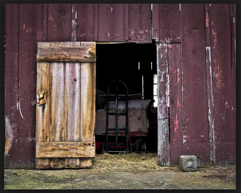 Open Barn Door perfect close up open barn door detail of the old with padlock
