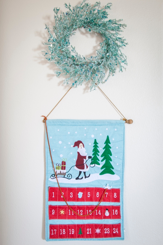 I love this wreath, and this advent calendar is darling. Emma's the biggest date changer.