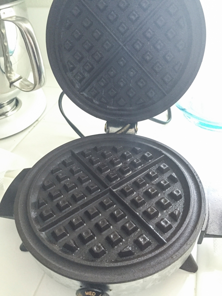 My 25 year old waffle iron, hot and sprayed with coconut oil cooking spray. I really like the coconut oil spray for baking, it's light and slightly sweet.
