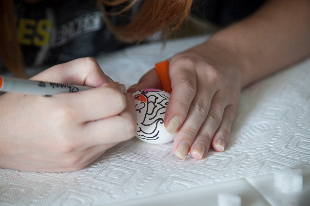 Speaking of drawing on eggs, here is Alix creating one of my favorite eggs.