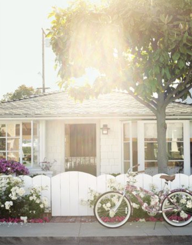 I just love so much about this image. The light, the fence, the bike. don;t you just want to cruise down to the beach on your beach cruiser? I say, YES! http://www.housebeautiful.com/decorating/beach-house-decorating-ideas-0710