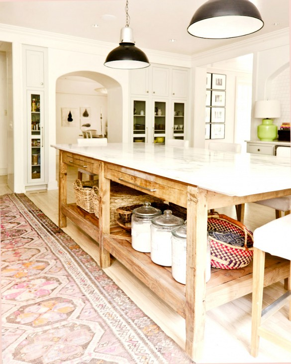 I really love this big chunky table as the kitchen island. I think I'm going to head over to a few antique stores in Orange and see what I can find for island options. http://www.domainehome.com/persian-rugs-for-the-kitchen