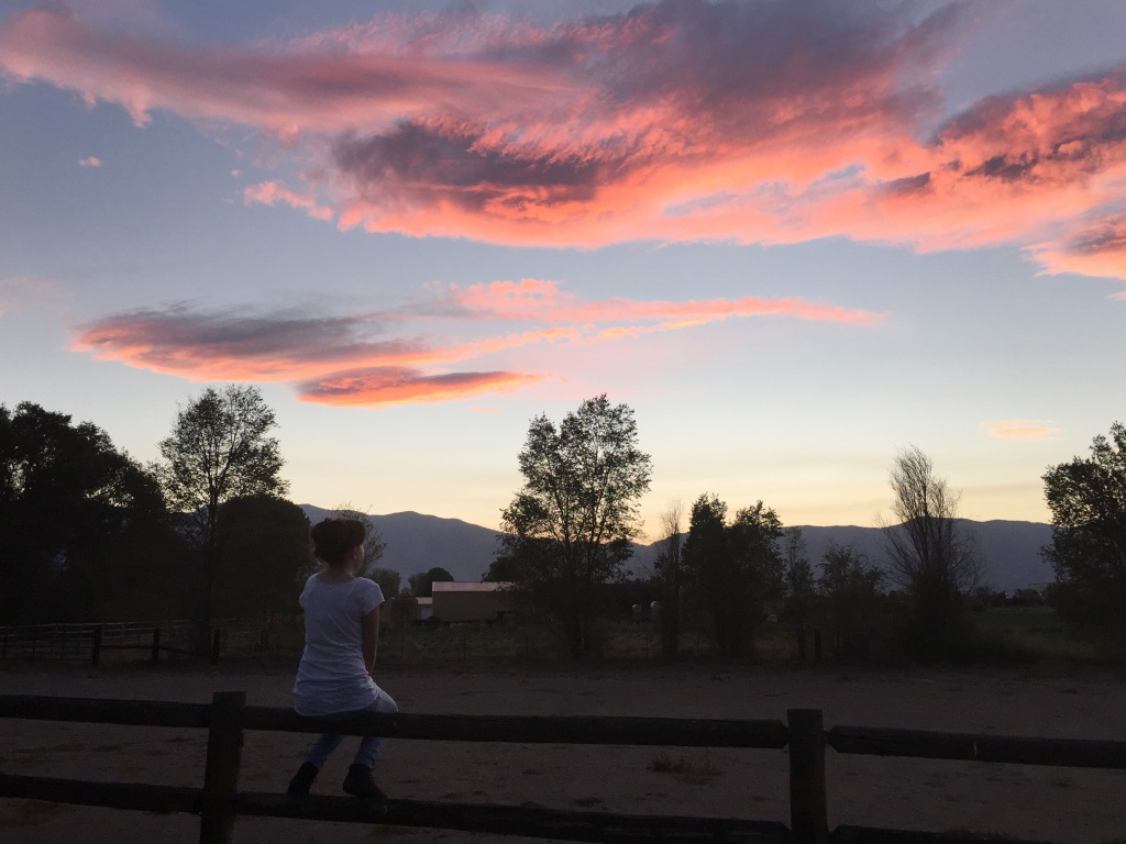 Emma watching the sunset.