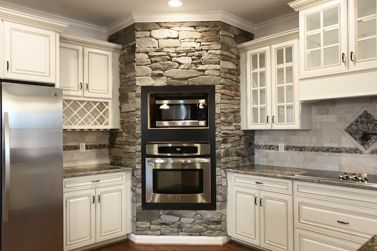 Look at this! I would have never thought of putting rock around the oven! It looks so cool. I know I'm not going to do this but now I have an idea stored in my head about just one more possibility. That's how this works.