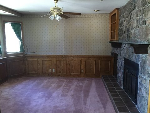 This is what the den looked like when we bought the house. Pink carpet and beautiful wood paneling. We would have left the wood, as it's solid oak and in beautiful shape, however, in order to build up the floor we had to remove it. Not a single piece was broken during removal. You'll be seeing it again!