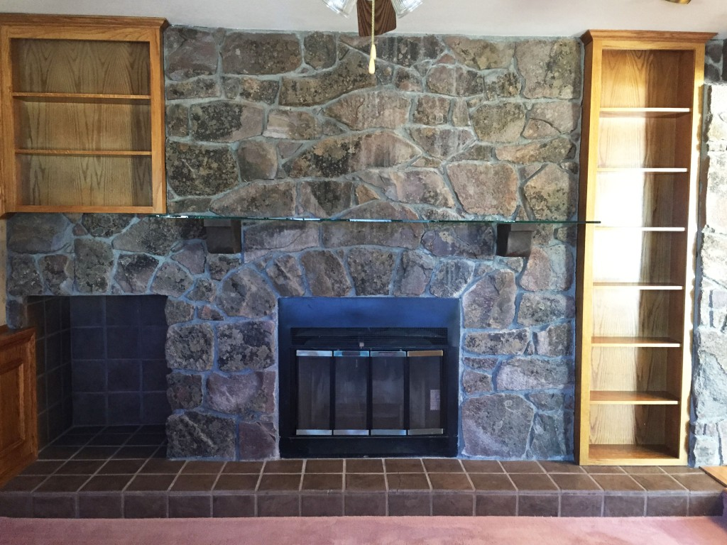 Here is another view of the fireplace in the room. Notice the glass mantle. What? Glass and dark chunky rocks, my favorite! Notice the sarcasm.