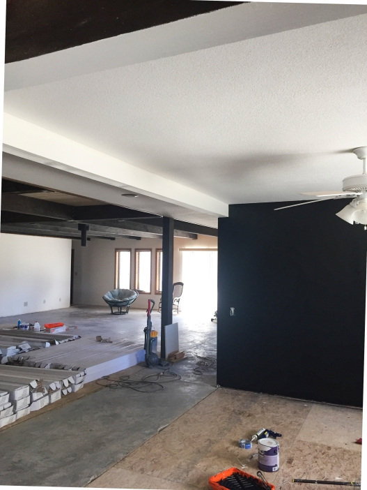 I really like the contrast of the black against the white beams. It looks so clean and sharp. It sort of freaked me out to see something so current in the house.